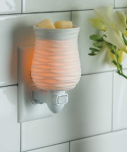 Harmony Pluggable Fragrance Warmer plugged into powerpoint