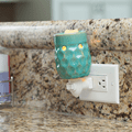 Honeycomb Turquoise Pluggable Fragrance Warmer plugged in powerpoint on kitchen benchtop