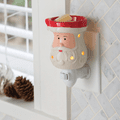 Santa Pluggable Fragrance Warmer plugged into powerpoint