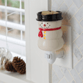 Snowman Pluggable Fragrance Warmer plugged into powerpoint
