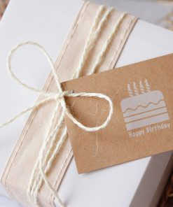 Gift Pack White Box displayed with ribbon and twine and happy birthday gift tag closup