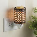 Moroccan Metal Pluggable Fragrance Warmer plugged into wall power point no 2