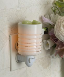Serenity Pluggable Fragrance Warmer plugged into power point on wall