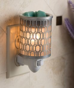 Filigree Pluggable Fragrance Warmer displayed with green coloured soy melts