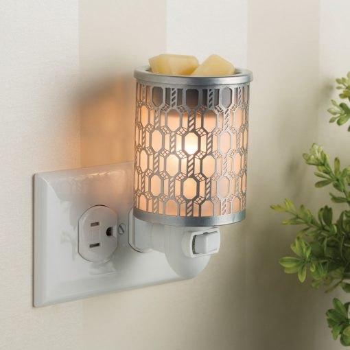 Filigree Pluggable Fragrance Warmer displayed with soy melts in warmer