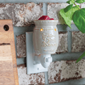 Follow Your Dreams Pluggable Fragrance Warmer plugged into powerpoint on brick feature wall