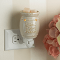 Follow Your Dreams Pluggable Fragrance Warmer plugged into powerpoint on wall