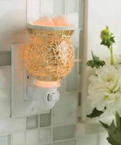 Gilded Glass Pluggable Fragrance Warmer plugged into powerpoint on wall