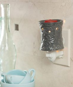 The Rainstorm Pluggable Fragrance Warmer features a organic, yet modern embossed pluggable warmer makes a great addition to a kitchen or small room.